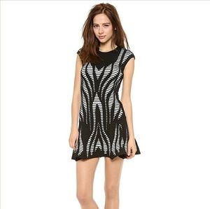 NWOT RVN knit lazer cut out b&w illusion dress
